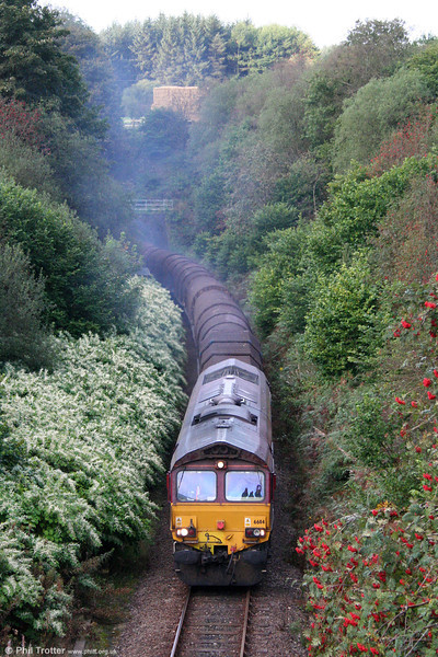 66114 makes a smoky exit from Sugar Loaf Tunnel with 6Z32, 0552 Margam to Llanwern on 20th September 2009.