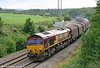 66131 passes Llangewydd with 6V78, 0459 Wembley to Margam SNCF empties on 28th July 2009.