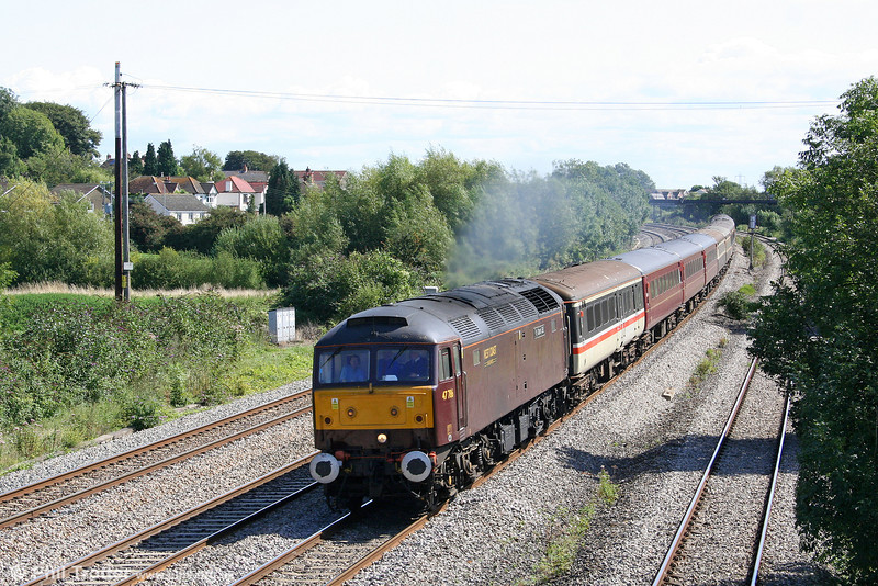 West Coast's 47786 'Roy Castle OBE' passes Magor at the head of Nenta's 1Z61, 0504 Norwich to Cardiff Central, the 'Cheddar Gorge & the Welsh Capital' railtour on 22nd August 2009.