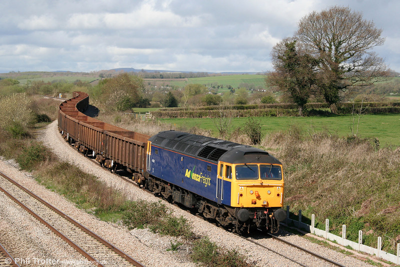 In perfect conditions, 47237 descends from Bishton Flyover with 6E66, 0950 Cardiff Tidal Sidings to Shipley on 7th April 2009.