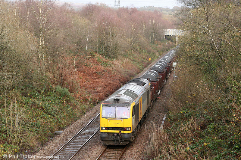 Making a return to South Wales after an absence of at least three years, 60084 'Cross Fell' passes Llangyfelach with 6B12, 1414 Margam to Trostre on 22nd November 2009.