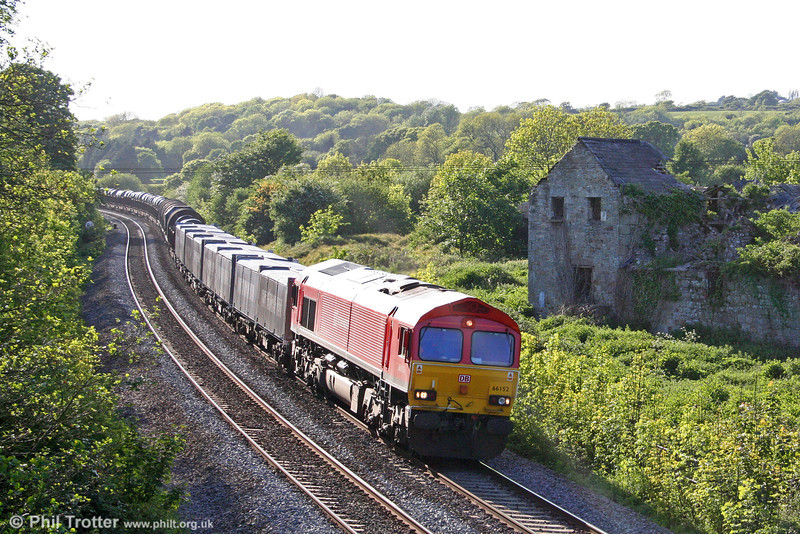 Having spent a couple of days working out of Margam, DB liveried 66152 passes Llangewydd at the head of 6E20, 1835 Margam to Immingham Sorting Sidings on 21st May 2009.