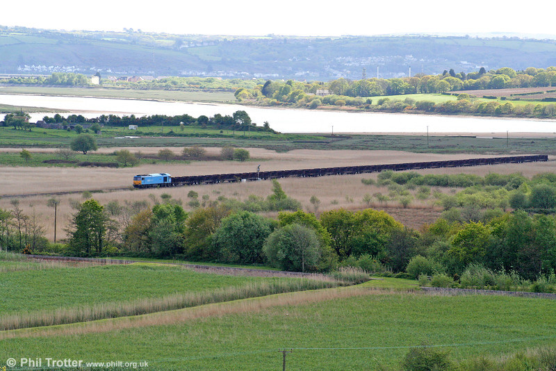 The Loughor Estuary forms a backdrop to 60074 'Teenage Spirit' as it passes Llangennech with 6B64, 1625 Trostre to Margam empties on 3rd May 2009.