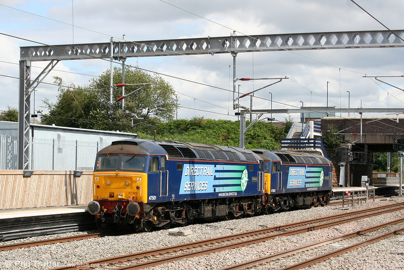 DRS 47802 'Pride of Cumbria' and 47501 'Craftsman' pass Tamworth running as 0Z47, 1240 Crewe Gresty Bridge to Tonbridge on 3rd August 2009.