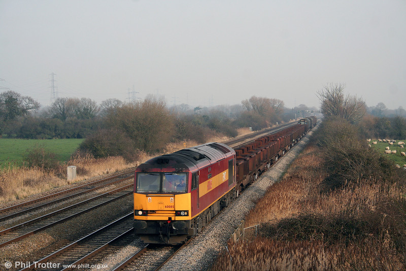 60085 'Mini - Pride of Oxford' returns through a sunny Coedkernew with 6H26, 1330 Llanwern to Margam on 10th January 2009.