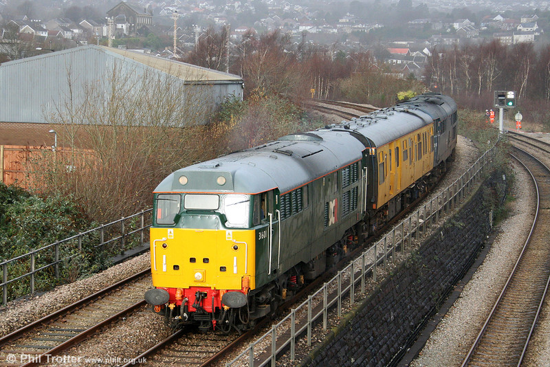 Newly repainted in Devon & Cornwall Railways/British American Railways green livery, 31601 approaches Swansea Loop East Junction with test train 2Z08, 0458 Whitland to Bristol Temple Meads via Pembroke Dock, Fishguard and Milford Haven on 9th December 2009. Track Recording Coach DB999508 is sandwiched between 31601 and BR blue 31106.