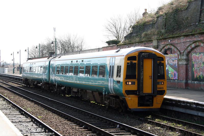 158823 rolls into Shrewsbury forming the 1124 Birmingham to Holyhead on 14th March 2009.