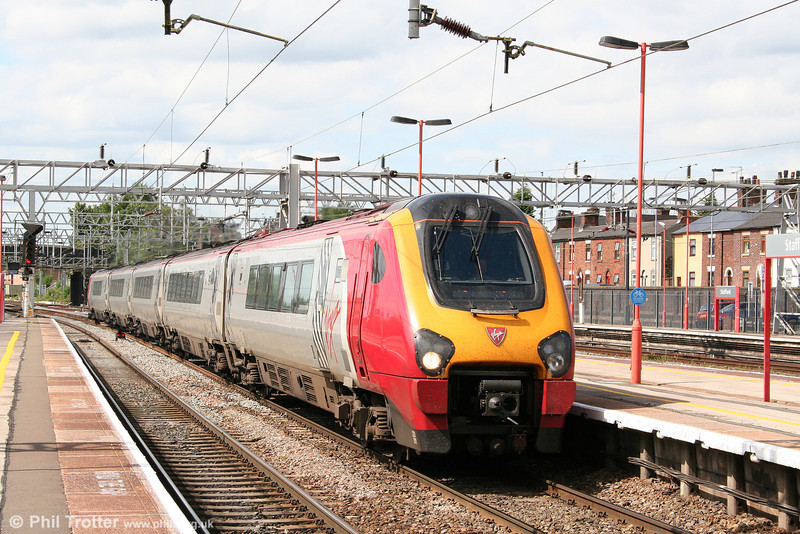 VWC 221101 'Louis Bleriot' is seen at Stafford forming the 1200 Glasgow to Birmingham New Street on 5th August 2009.