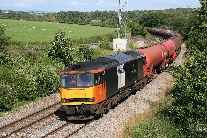 Load Haul liveried 60059 'Swinden Dalesman' passes Llangewydd at the head of 6B33, 1212 Theale to Margam on 18th July 2009.
