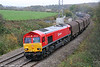 Red Shed: DB Schenker liveried 66152 stands out from the gloom at Llangewydd with 6V78, 0459 Wembley to Margam SNCF wagons on 31st October 2009.