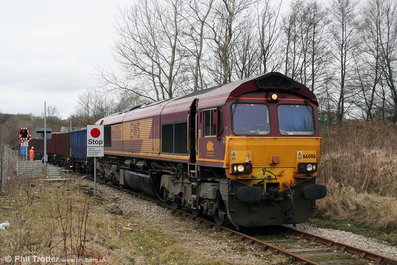 66086 hauls its train over the level crossing at Gwaun Cae Gurwen with 6G05, 1030 Swansea Burrows to Gwaun Cae Gurwen on 6th March 2009.