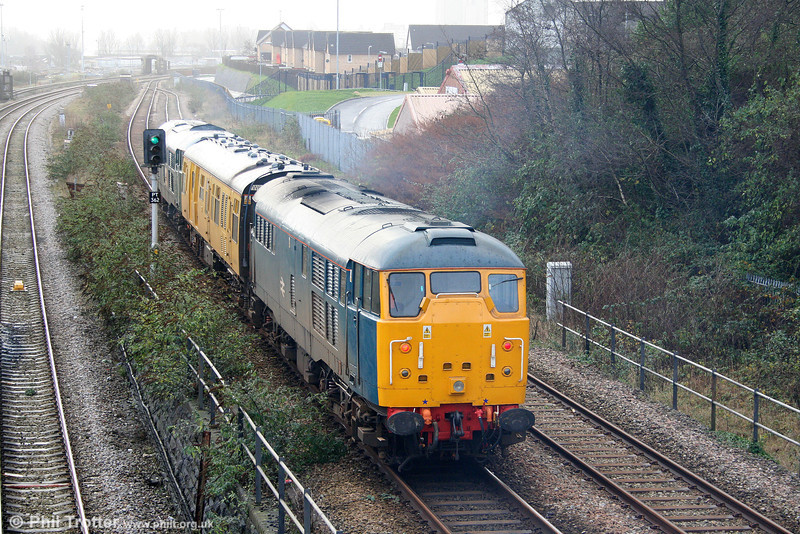 BR blue 31106 brings up the rear of test train 2Z08, 0458 Whitland to Bristol Temple Meads via Pembroke Dock, Fishguard and Milford Haven at Swansea Loop East on 9th December 2009.