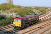 Stranger in town: 59202 'Vale of White Horse' passes Llandeilo Junction running as 0A11, 1754 Margam to Robeston on 20th April 2009. The loco was being trialled as a possible replacement for class 60s on the fuel tanker trains and was due to work 6A11, 2246 Robeston to Theale later that evening. In the event, 59202 failed and 60065 was summoned to assist.