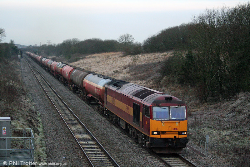 60024 slogs up the 1 in 93 gradient to Stormy Summit with 6B13, 0510 Robeston to Westerleigh loaded Murco tanks on 24th January 2009.