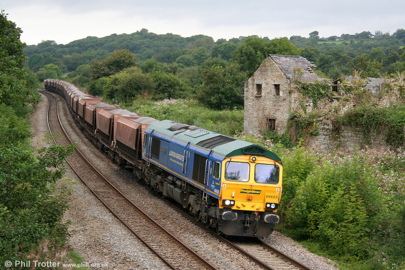Freightliner's Bardon Aggregates liveried 66623 'Bill Bolsover' passes Llangewydd with 6B75, 1338 Neath Abbey Wharf to Cardiff Pengam on 31st August 2009.