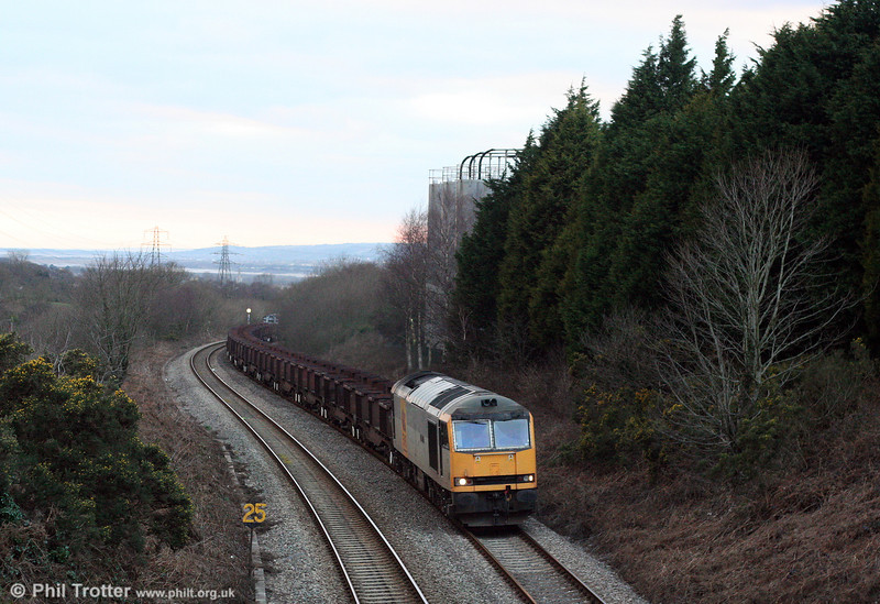 Class 60 sunset? 60072 'Cairn Toul' climbs Cockett Bank at the head of the diverted 6B64, 1625 Trostre to Margam empties on 1st February 2009.