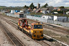 Colas Rail's Geismar TRAMM (Track Renewal And Maintenance Machine) DR98307 passes Severn Tunnel Junction on 7th April 2009.