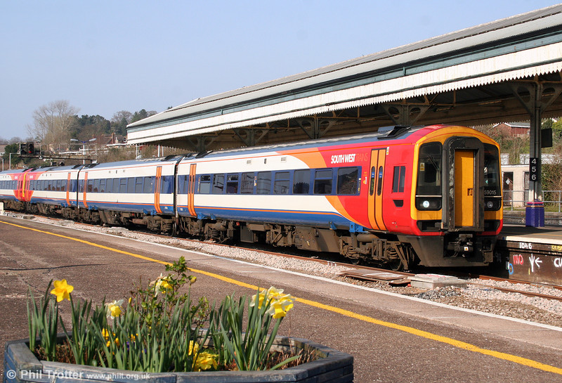 In the spring sunshine, 159015 runs into Exeter St. Davids to form the 1530 service to Honiton on 21st March 2009.