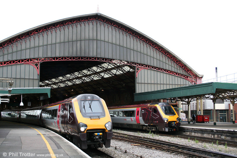 The present day scene at Bristol Temple Meads. Left, 220020 departs with the 0659 Paignton to Edinburgh, while 221131 waits with the 1000 service to Manchester Piccadilly on 15th August 2009.