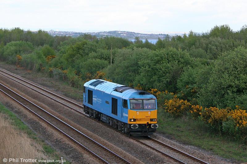 60074 'Teenage Spirit' ambles towards Burry Port as 0B07, 1754 Margam to Robeston on 27th April 2009.