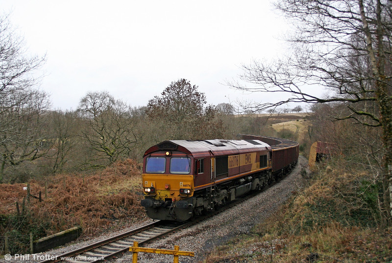 66076 approaches Nant-y-Cafn Farm crossing with 6F81, 1350 Onllwyn to Margam empties on 17th January 2009. The abandoned HTA (right) is a reminder of an earlier mishap on this steeply graded line.
