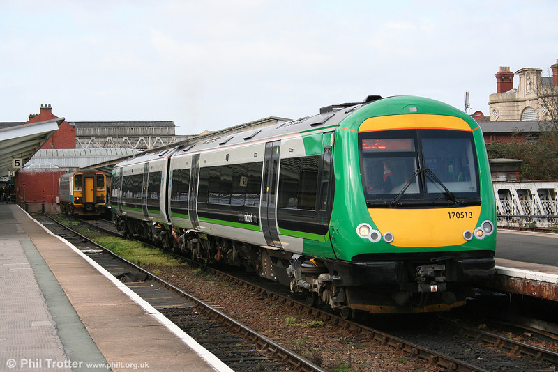 London Midland 170513 leaves Shrewsbury forming the 1347 service to Birmingham New Street on 14th March 2009.
