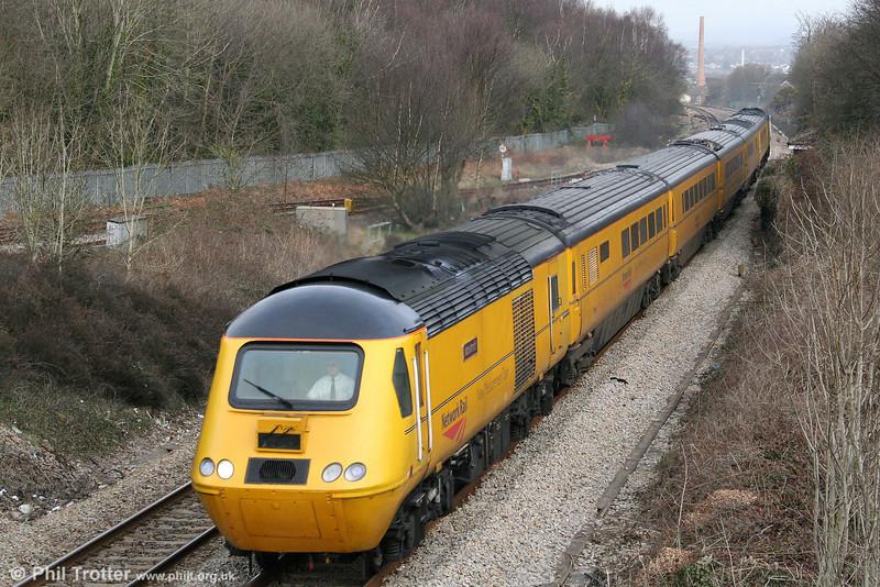43062 'John Armitt' heads 1Z20, 1005 Swansea to Derby NMT through Briton Ferry on 6th March 2009.