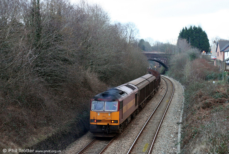 60024 brings up the rear of 6B64, 1625 Trostre to Margam empties at cockett on 1st February 2009.