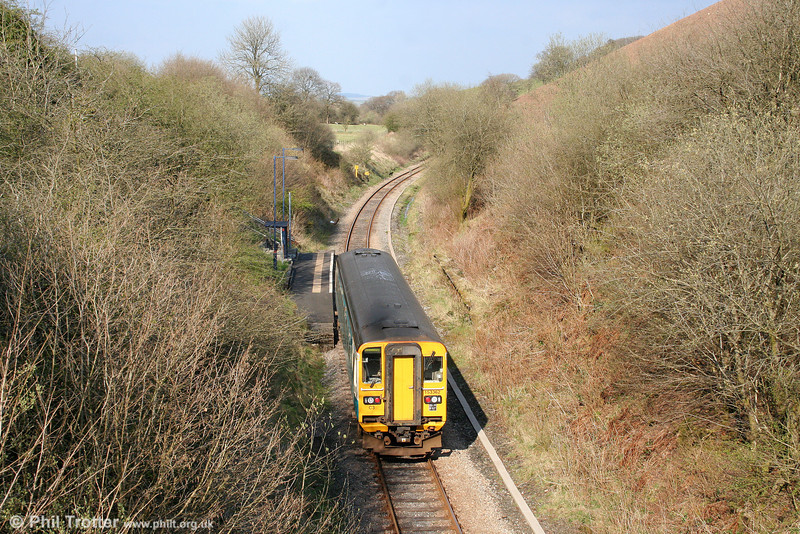 153362 passes through the little used Sugar Loaf Summit Halt forming the 1510 Swansea to Crewe on 12th April 2009. This section was once double track; the remains of the second platform can still be seen to the right.