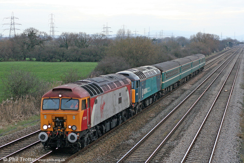 57303 'Alan Tracy' and ATW liveried 57315 pass Coedkernew with 5U89, 1121 Taunton to Cardiff Canton ECS on 19th December 2009. The Anglia-liveried MkII set is that now employed on the weekday Cardiff - Taunton diagram.