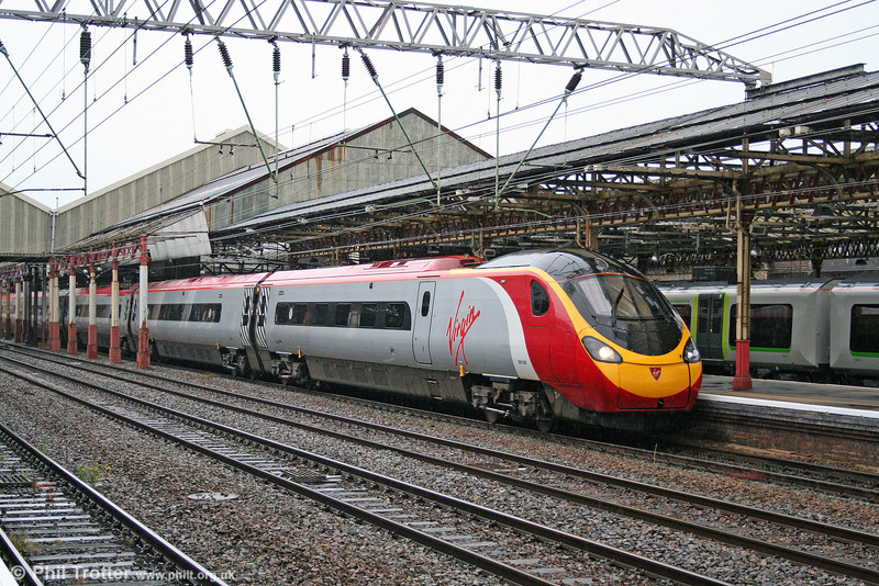 Pendolino 390029 'City of Stoke-on-Trent' departs from Crewe forming the 1755 Manchester Piccadilly to London Euston on 16th July 2009.