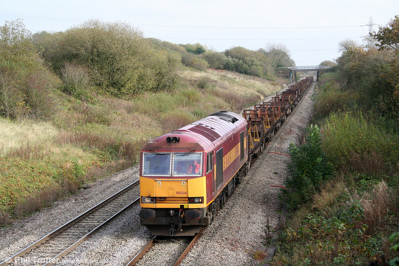 60004 descends Stormy Bank in autumn sunshine with 6H24, 1123 Llanwern to Margam on 31st October 2009.