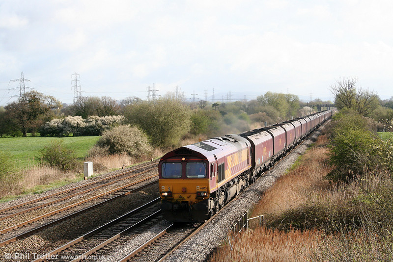 66105 passes Coedkernew at the head of 6F66 0658 Newport Docks to Aberthaw P.S. on 7th April 2009.