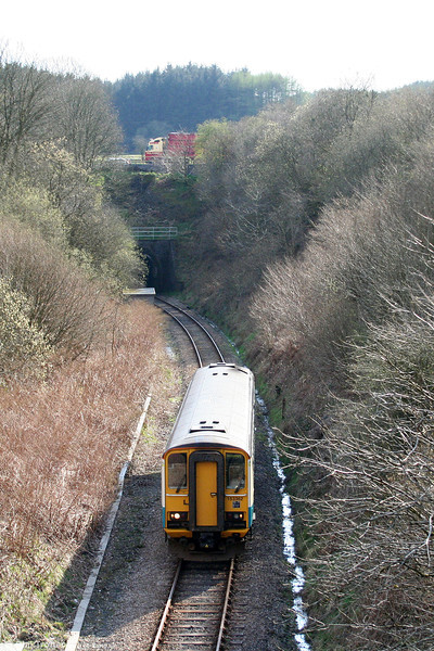 153362 has passed through the 1000 yard Sugar Loaf Tunnel to reach the summit forming the 1510 Swansea to Crewe on 12th April 2009.