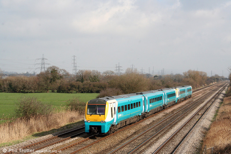 175105 and a 175/0 sister pass Coedkernew forming the 1011 Hereford to Milford Haven on 1st March 2009.