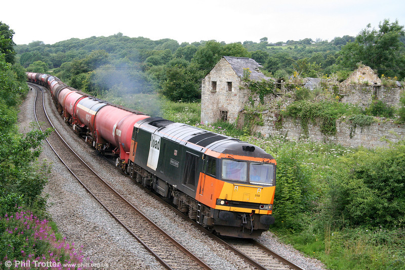 A few minutes after the previous shot, 60059 'Swinden Dalesman' is seen at Llangewydd with 6B13, 0510 Robeston to Westerleigh on 28th July 2009.