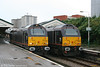 The Royal Couple: Two locos which are seldom seen side by side, as they normally work at opposite ends of the Royal Train! 67005 'Queen's Messenger' and 67006 'Royal Sovereign' at Swansea having arrived with a Cargo D rake which was being used for filming a television drama on 25th October 2009.
