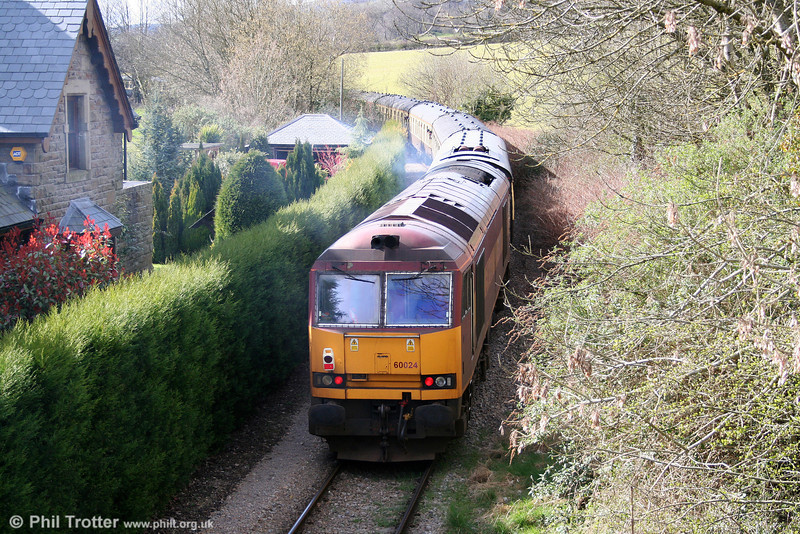 60024 at the rear of the 1302 Tondu to Machen section of Pathfinder's 'Cwm and Go' railtour as it passes the former Church Road Station, Machen on 28th March 2009.