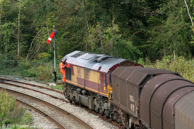 The shunter leaves the cab of 66157 to uncouple the loco from its train on the Llynfi Goods Loop on 4th October 2009. The train is 6H26, 1430 Llanwern to Margam.
