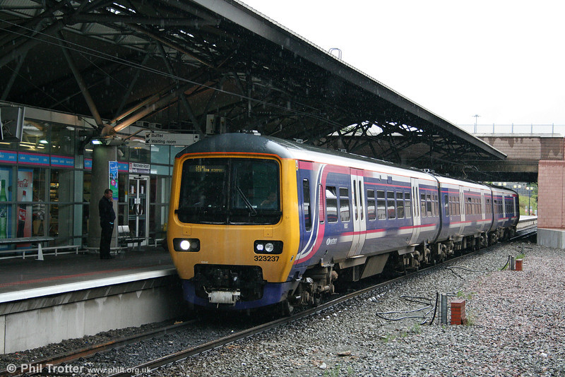 Northern's 323237 arrives at Manchester Airport forming the 1646 Manchester Piccadilly to Crewe on 17th July 2009.