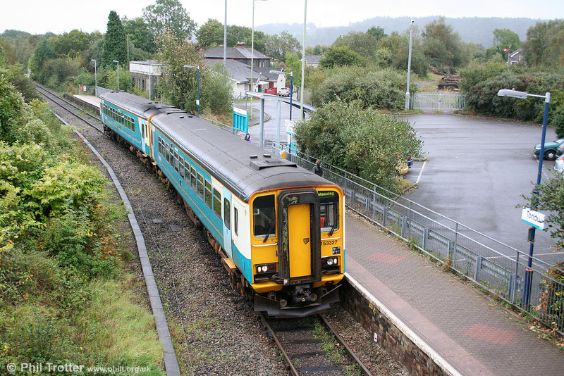 Deputising for a class 158, 153327 and 153362 are seen at Tondu forming the 0845 Cheltenham Spa to Maesteg on 3rd October 2009.
