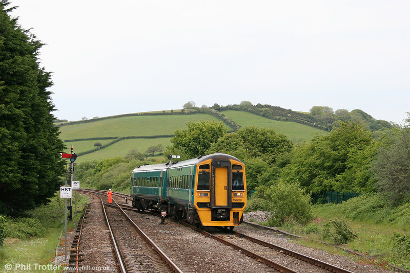 Engineering work over the Spring Bank Holiday weekend resulted in the Manchester to Milford Haven services being truncated to run between Hereford and Ferryside only. Here, 158828 crosses from the down to the up main at Ferryside ready to work the 1410 departure back to Hereford on 25th May 2009.