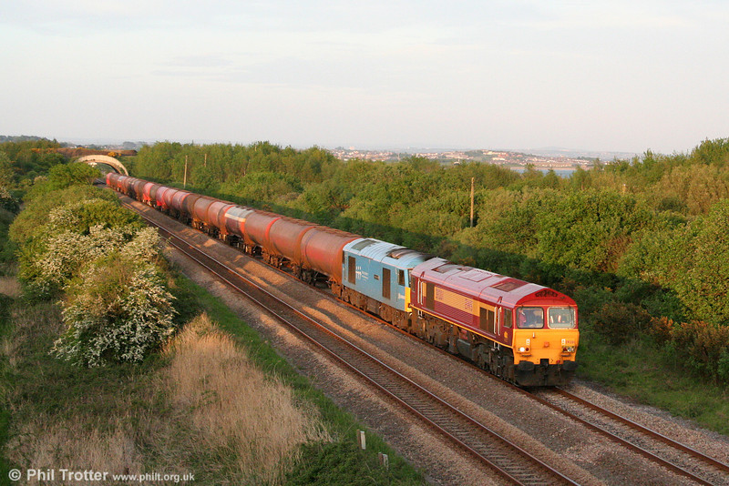 59201 'Vale of York' and 60074 'Teenage Spirit' head 6B33, 1335 Theale to Robeston towards Burry Port at sunset on 12th May 2009. This was a second attempt to trial the Robeston tanks behind a class 59; 59201 was added at Margam.