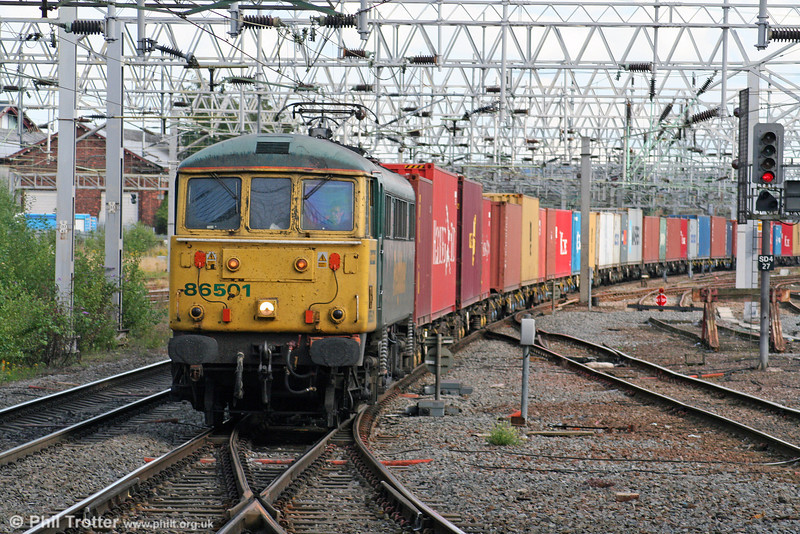 The unique, regeared 86501 approaches Stafford with 4M88, 0849 Felixstowe to Crewe on 5th August 2009.