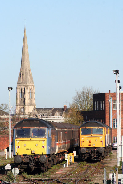 The spire of St. Paul's Church, Gloucester forms a backdrop to Cotswold/Advenza 47818 'Emily' and 47237 on 11th April 2009.