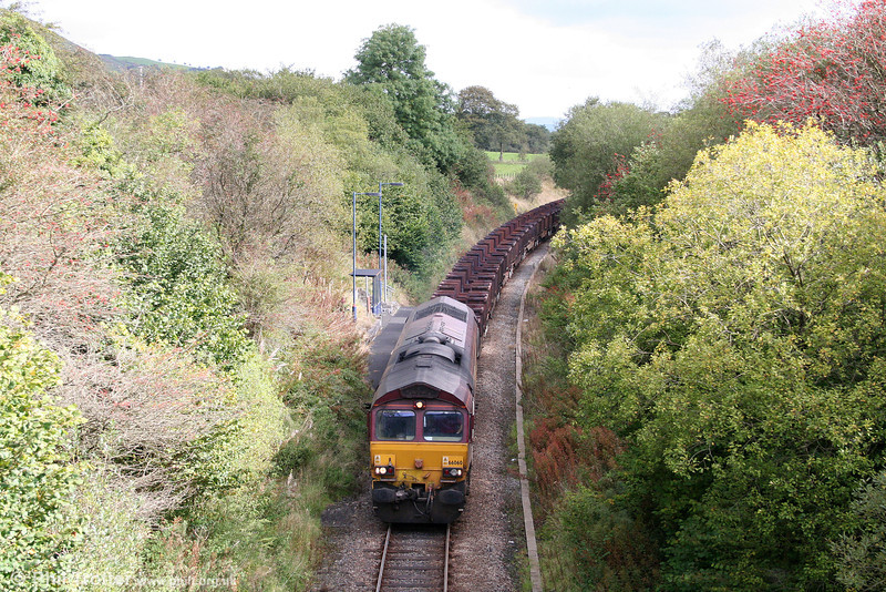 Closure of the South Wales Main Line for engineering works on 19/20 September resulted in a number of freight diversions over the Heart of Wales Line. 66060 passes Sugar Loaf Summit Halt with 6Z22, 0555 Llanwern to Margam on 20th September 2009.