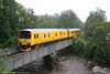 Network Rail's class 150-derived Track Assessment Unit 950001 made a visit to the Gwaun Cae Gurwen branch on 29th July 2009, running as 2Z08 from Shrewsbury. In yet another summer downpour, the unit is seen here crossing the River Amman at Pontamman on the return journey to Shrewsbury.