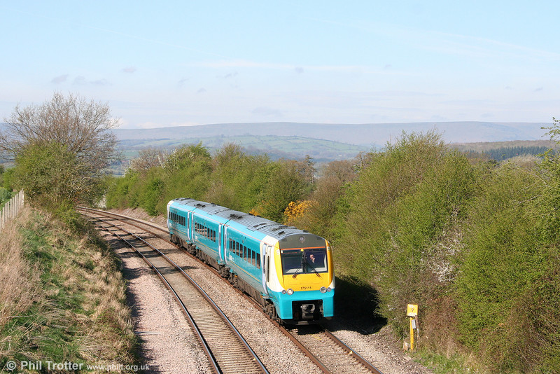 175111 is seen at Wormbridge, working the 0705 Milford Haven to Manchester Piccadilly on 13th April 2009.