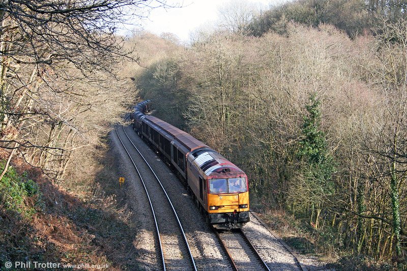 If you go down to the woods today... 60085 'Mini - Pride of Oxford' winds its way through Penllergaer Forest on the Swansea District Line with 6B12, 1414 Margam to Trostre on 15th February 2009.