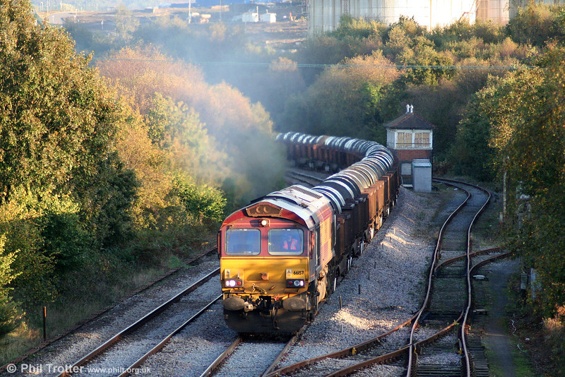 66157 catches the low evening sun at Llandarcy with 6B48, 1607 Margam to Trostre on 12th October 2009.